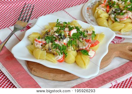 Pasta with mushrooms, crab sticks and parsley