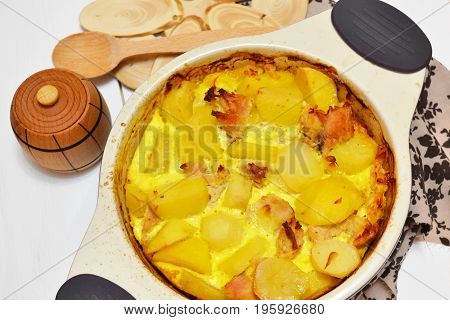 Potato casserole with meat and cheese in a baking dish
