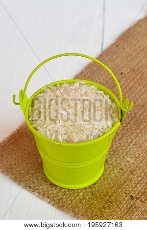 Basmati long grain rice in green metal bucket