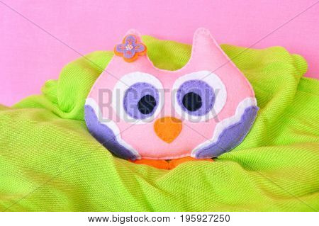 Felt owl - handmade felt colorful owl toy on pink and green background