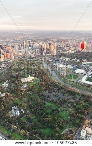 Melbourne Australia - September 15 2013: aerial view of a hot air balloon floating over the MCG and Melbourne sporting precinct at dawn.