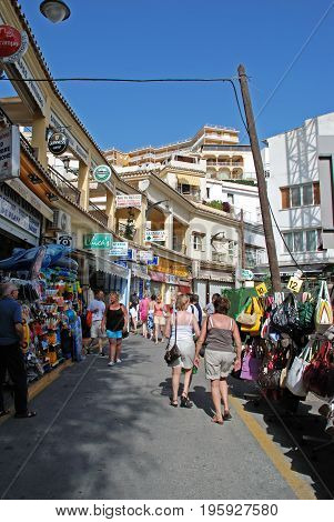 TORREMOLINOS, SPAIN - SEPTEMBER 3, 2008 - Tourists walking along an old town shopping street Torremolinos Malaga Province Andalusia Spain Western Europe, September 3, 2008.