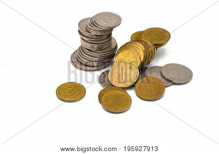 coins in different currency on a white background