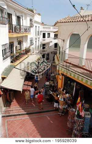 TORREMOLINOS, SPAIN - SEPTEMBER 3, 2008 - Elevated view of tourist shopping street in the old town Torremolinos Malaga Province Andalusia Spain Western Europe, September 3, 2008.