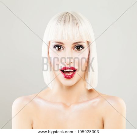 Surprised Female Face. Happy Surprised Woman with Makeup and Blonde Hairdo
