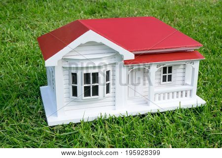 Bungalow villa house model in Australian or New Zealand NZ victorian style on lawn grass - side view