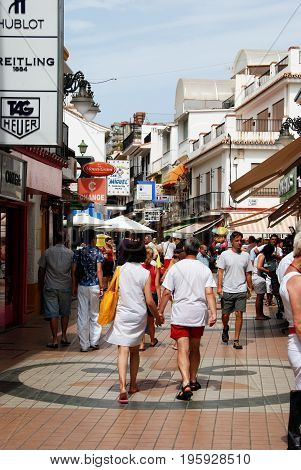 TORREMOLINOS, SPAIN - SEPTEMBER 3, 2008 - Tourists walking along Calle San Miguel shopping street in the old town Torremolinos Malaga Province Andalusia Spain Western Europe, September 3, 2008.