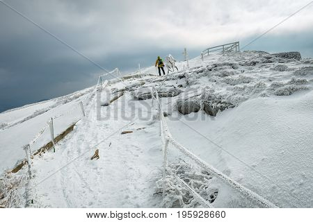 Mountain Hiker In Bad Weather During Winter