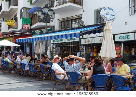 TORREMOLINOS, SPAIN - SEPTEMBER 3, 2008 - Tourists relaxing at town centre pavement cafes Torremolinos Malaga Province Andalusia Spain Western Europe, September 3, 2008.