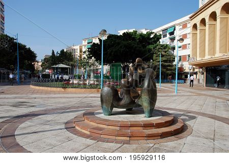 TORREMOLINOS, SPAIN - SEPTEMBER 3, 2008 - Modern art statue with a fountain to the rear in a town square Torremolinos Malaga Province Andalusia Spain Western Europe, September 3, 2008.