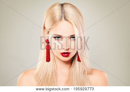 Beautiful Blondie Woman Fashion Model with Blonde Hair Red Lips Makeup and Red Earrings