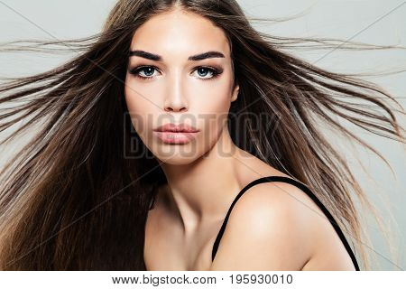 Fashion Portrait of Cute Brunette Woman with Long Hair and Makeup