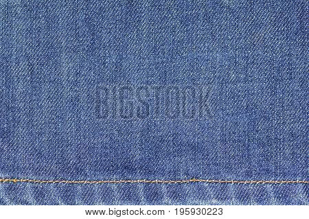 Denim jeans fabric texture background with seam for beauty, fashion and clothing idea concept design.