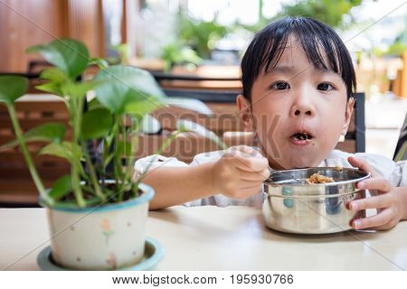 Asian Chinese Little Girl Eating Fried Rice