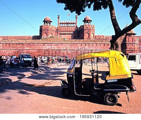 DELHI, INDIA - NOVEMBER 20, 1993 - View of the Red Fort with a motor rickshaw in the foreground Delhi Delhi Union Territory India, November 20, 1993.
