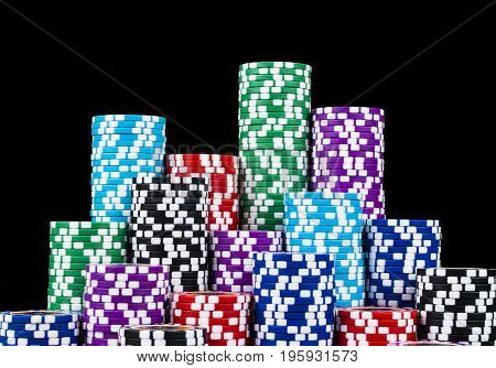 Stack of Poker chips isolated on a black background. poker table. Poker game concept. Playing a game with dice. Casino Concept for business risk chance good luck or gambling. chips for poker game