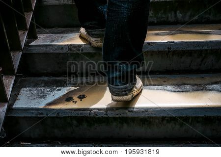 Close up legs of the man walking stepping up stair in  the city,  go up, success, grow up business concept