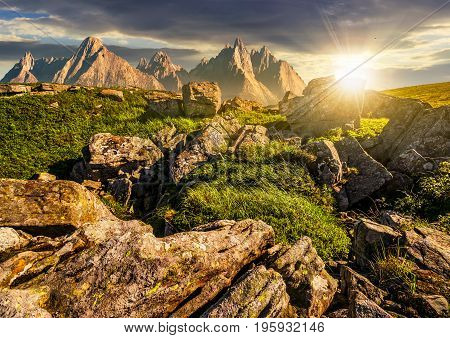 Rocky Peaks And Rocks On Hillside In Tatras At Sunset