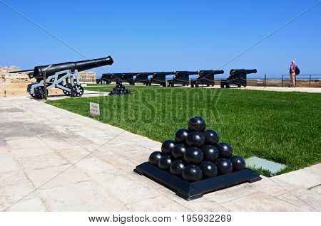 Cannons in Upper Barrakka Gardens with Cannonballs in the foreground Valletta Malta Europe.