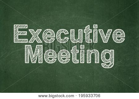 Business concept: text Executive Meeting on Green chalkboard background
