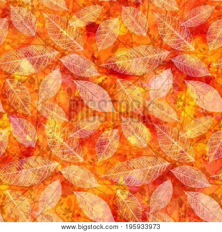 A seamless pattern with autumn leaves silhouettes and tree branches on an abstract vibrant red, yellow, and orange background. A fall repeat print with organic motifs