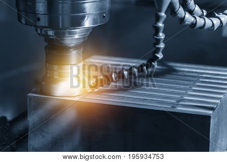 The CNC milling machine cutting the sample part with the flat endmill in light blue scene.The rough endmill cutter for CNC machine with lighting effect