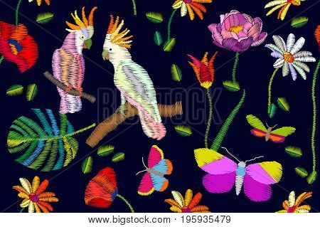 Seamless vector pattern with cockatoos, palm leaves and flowers. Embroidered texture. Vintage textile collection.