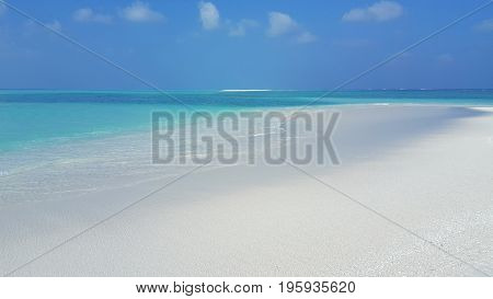 Maldives beautiful white sandy beach background on sunny tropical paradise island with aqua blue sky sea water ocean 4k