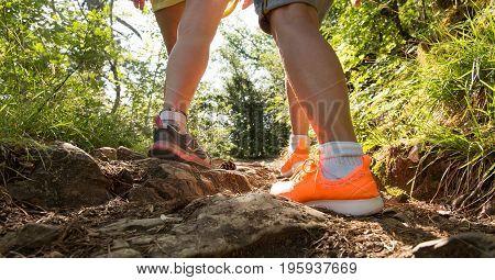 Traveler legs two women walking on the path