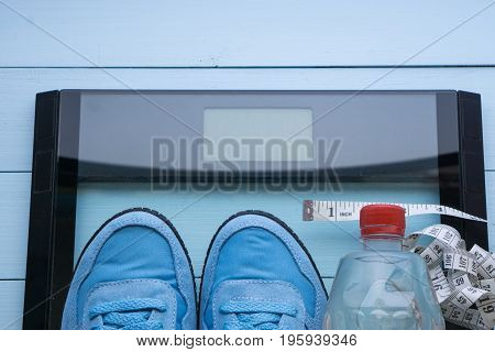Blue Sneakers, Water, Digital Scale On Blue Background