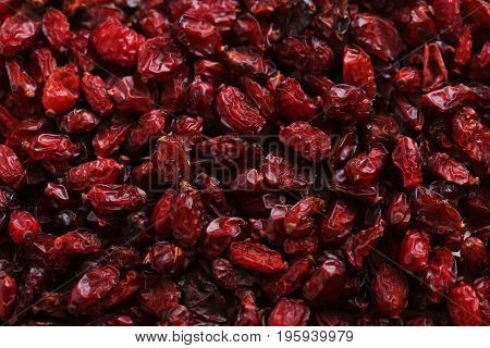 Pile of dry barberries background, close up