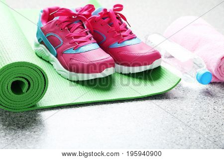 Pink Sport Shoes With Green Fitness Mat