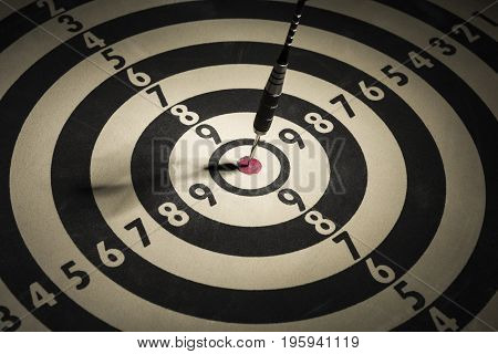 One dart in the center of the target