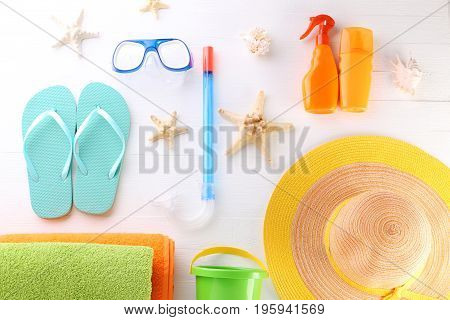 Beach accessories on the white wooden table