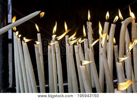 Wax Candles Lit With Fire