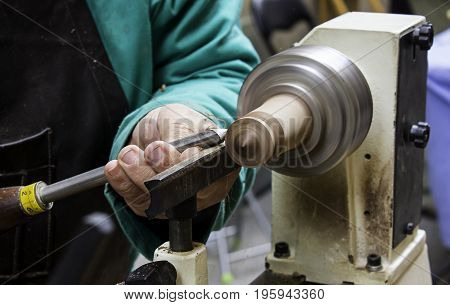 Man Working With A Wood Lathe