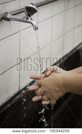 Young person washing their hands hygiene and cleaning detail