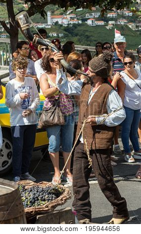 ESTREITO DE CAMARA DE LOBOS PORTUGAL - SEPTEMBER 10 2016: People wearing in traditional costumes at Madeira Wine Festival in Estreito de Camara de Lobos Madeira Portugal.