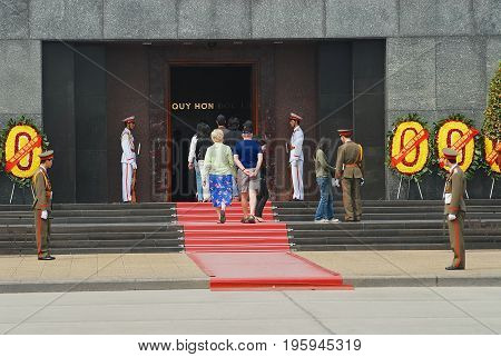 HANOI, VIETNAM - FEBRUARY 08, 2007: Unidentified foreign tourists visit Memorial of Ho Chi Minh at his Mausoleum at Ba Dinh square in Hanoi, Vietnam.