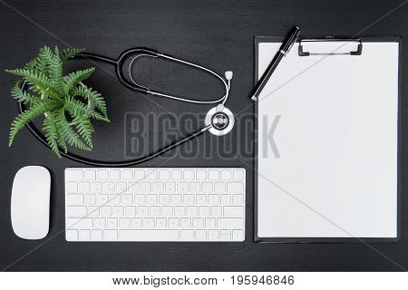 arranged digital devices clipboard pen and stethoscope isolated on grey