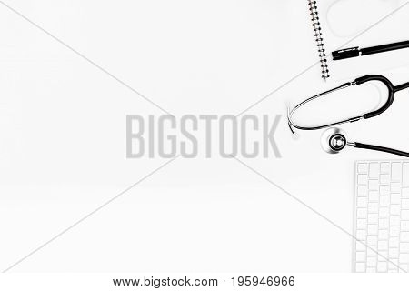 Flat Lay With Stethoscope, Keyboard And Notebook With Pen Isolated On White