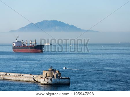 Tanker by Gibralter Seawall in Foggy Water