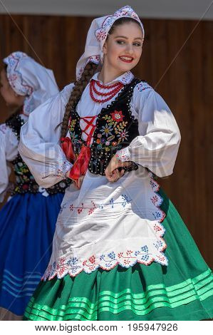 TIMISOARA ROMANIA - JULY 9 2017: Young dancer girl from Poland in traditional costume perform at the international folk festival