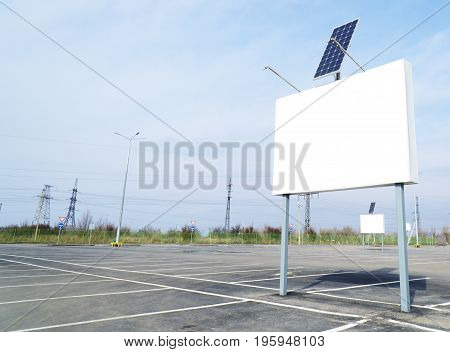 Billboard on empty parking with solar panel