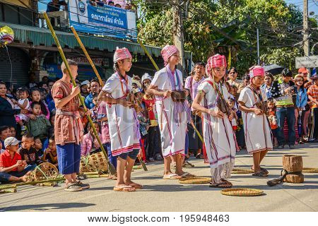 CHIANGMAI THAILAND - JANUARY 25 2015: Hill tribe traditional group dance show in parade of 22nd Traditional Skirt Fabric and The Indigenous Product and Culture Festival in Mae Chaem Chiangmai Thailand