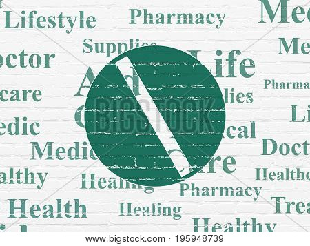 Healthcare concept: Painted green Pill icon on White Brick wall background with  Tag Cloud