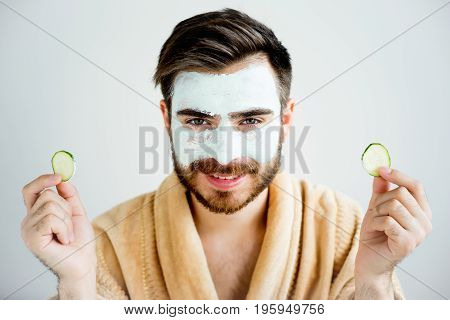 A portrait of a man with a mud mask