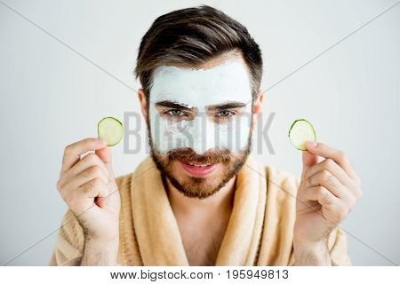 A portrait of a man with a clay mask