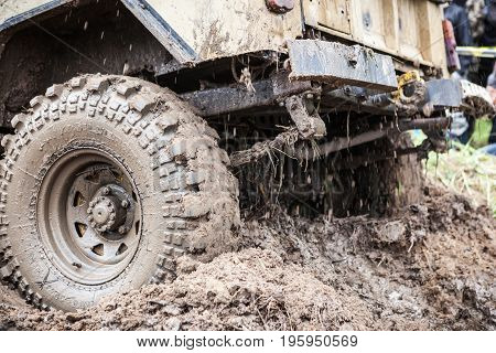 LUBOTIN UKRAINE - JULY 23 2016: RFC Ukraine Wild Boar Challenge 2016. Close u p of Uaz 469 overcomes a muddy pit.