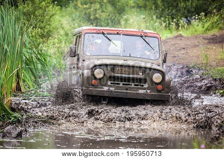 LUBOTIN UKRAINE - JULY 23 2016: RFC Ukraine Wild Boar Challenge 2016. Custom built Off-road Trophy UAZ 469 in the swamp at high speed.